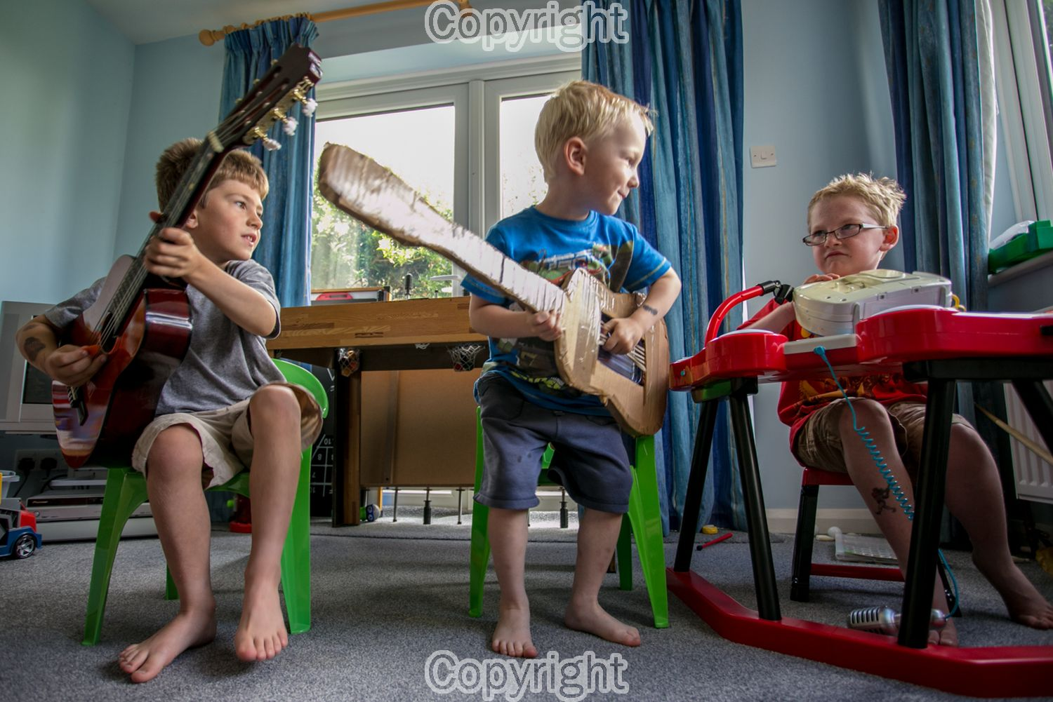 My two sons and their cousin concentrating hard in their cool band.