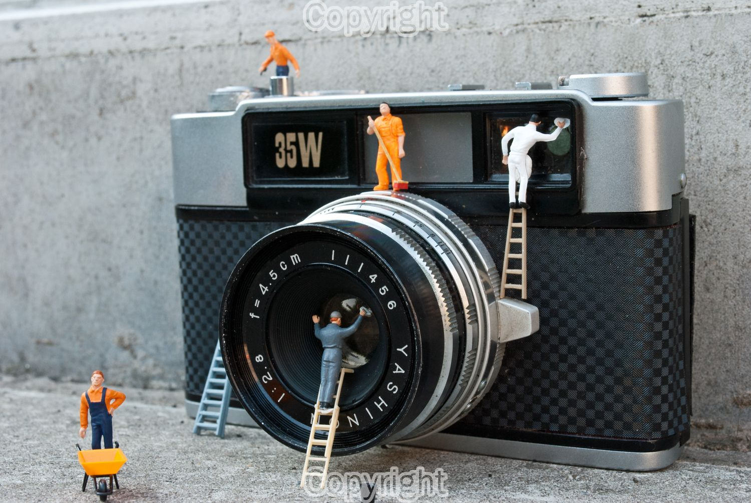 "Darren Hoyland: ""Little workers giving an old vintage camera a overhaul"" Equipment: Nikon D3100 & 18-55mm"